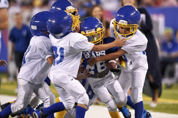 Football at young ages puts kids at significant risk for head trauma. Photo Credit: Carlos M. Saavedra/Sports Illustrated/Getty Images) CREDIT: Carlos M. Saavedra (Photo by Carlos M. Saavedra /Sports Illustrated/Getty Images)